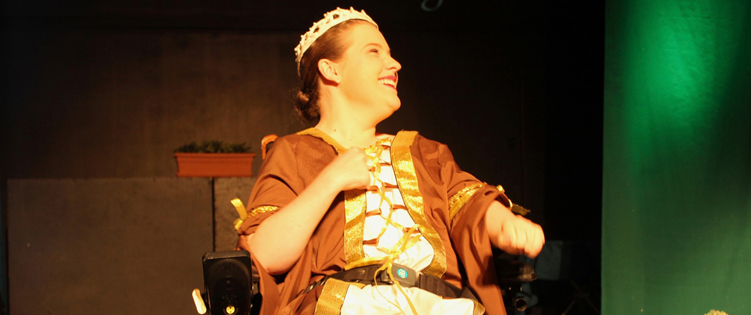 A woman smiles on stage